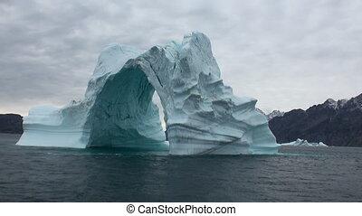 Iceberg arch like Darwin arch in Galapagos Islands....