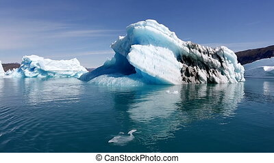 Iceberg fjord in Greenland - Drifting by an iceberg floating...