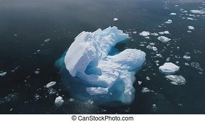 Iceberg floating in Antarctica ocean. Aerial shot.
