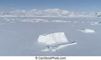 Iceberg freeze antarctica ocean water aerial - Iceberg...