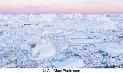 Iceberg from glacier in arctic nature landscape on Greenland - aerial video