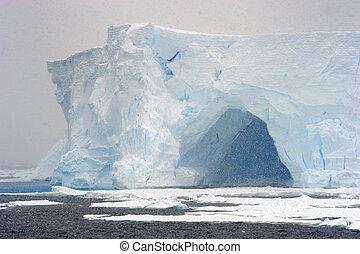 Iceberg in blizzard.