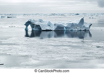 Iceberg in calm waters - Iceberg drifting in calm waters