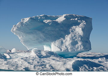 Iceberg in Nunavut with sunshine (canadian arctic sea)