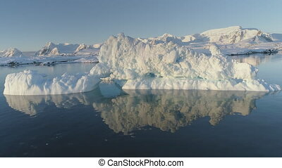 Iceberg melt in clear ocean water drone above view - Iceberg...