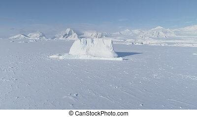 Iceberg stuck frozen antarctic ocean water aerial - Iceberg...