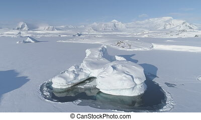 Iceberg stuck frozen antarctic ocean water aerial - Melting...