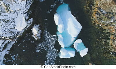 Iceberg stuck in peninsula ocean shore aerial view - Iceberg...