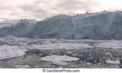 Iceberg wall - Sailing by a huge iceberg neat Ilulissat,...