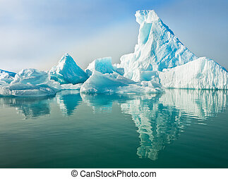 Icebergs Floating in Calm Water - Icebergs floating in calm...