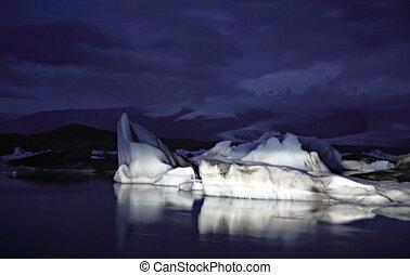 Icebergs, Iceland at night Jokulsarlon lagoon