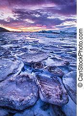 Icebergs in Jokulsarlon glacial lake during sunset, Iceland,...
