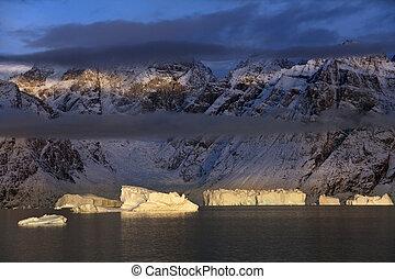 Icebergs in Scoresbysund - Greenland - Late afternoon sun on...