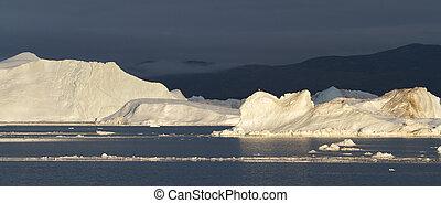 Icebergs in sunset