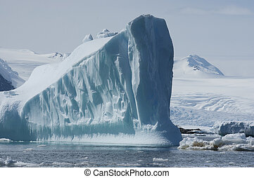 Icebergs in the background of mountains and glaciers.