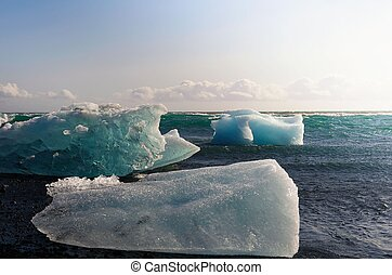 Icebergs lying on the Diamond Beach in Jokulsarlon Glacier Lagoon, Iceland