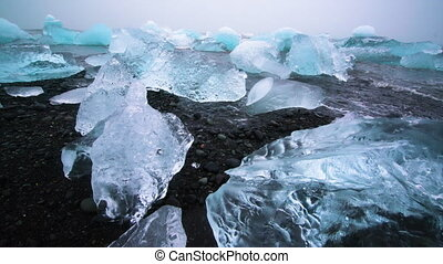 Icebergs on Diamond Beach in Iceland. Frozen ice on black ...