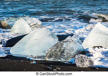 Icebergs on the coast of Diamond beach near Jokulsarlon in South Iceland