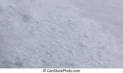 Icebreaker breaks ice on way to North pole. Lot of snow...