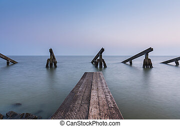 icebreakers with pier at the ocean