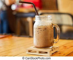Iced caffe mocha with milk foam, stock photo