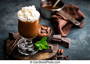 Iced cocoa drink with whipped cream, cold chocolate...