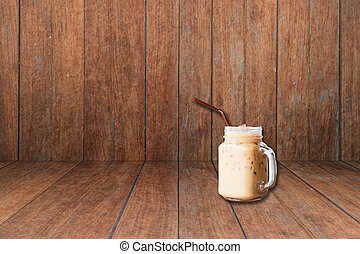 Iced coffee on old wooden interior texture background