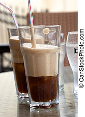 Two iced coffees served glasses
