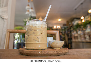 Iced coffee with milk is on the table.