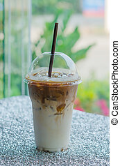 Iced coffee with straw in plastic cup for take aways