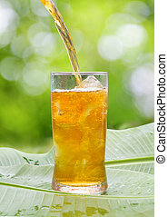 Iced Tea - Glass of cold iced tea on Banana leaves ,outdoor....