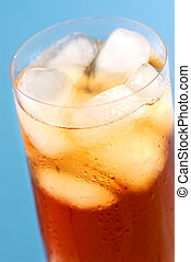Iced tea - Glass of regular cold iced tea with water drops...