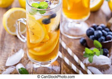 Iced tea with blueberries and lemon slices - Iced tea with...