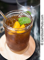 Iced tea with orange slices and mint