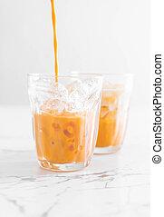 thai milk tea - iced thai milk tea in glass