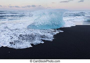 Iceland breaking Ice on black lava sand beach