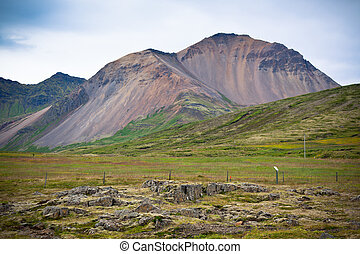 Iceland Caked Lava field and mountains landscape
