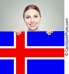 Iceland concept. Happy woman with the Icelandic flag background.