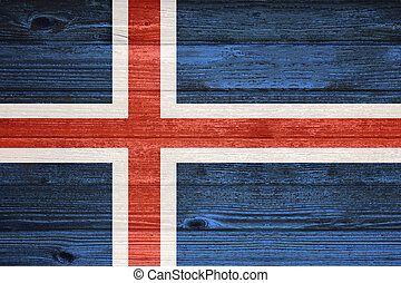 Iceland Flag painted on old wood plank background.