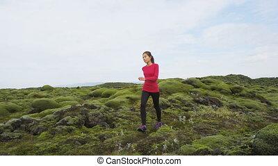 Iceland hiker hiking in moss nature landscape. Woman walking...