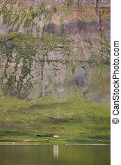 Iceland. Isafjardaraiup fiord. Landscape with house.