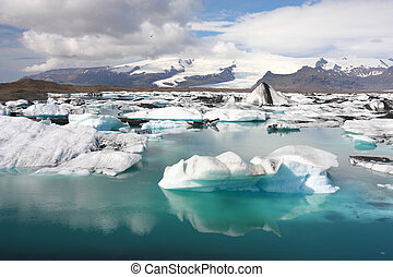 Iceberg on Jokulsarlon lagoon in Iceland. Famous lake. Travel destination for tourists next to Vatnajokull glacier.