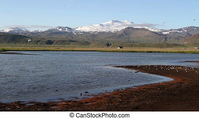 Beautiful wide shot of Iceland snowy mountains and sea