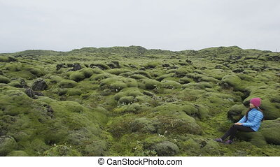 Iceland moss nature landscape with hiker relaxing - Iceland ...