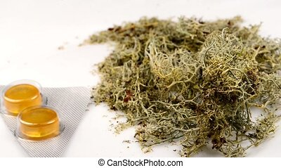 Iceland moss with cough tablets on a turn table