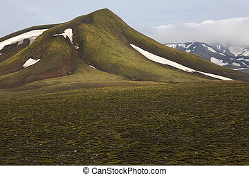 Iceland. South area. Fjallabak. Volcanic landscape with snow.