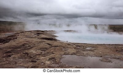 Iceland, steam of hot water in the geyser valley - steam of...