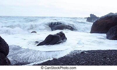 Iceland, surf on black beach. South coast, Vic - Iceland,...