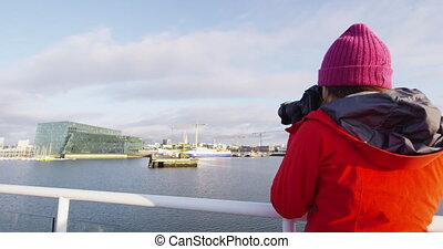 Iceland tourist photographer on harbour cruise and whale ...