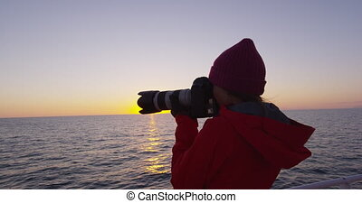 Iceland tourist photographer on harbour cruise and whale watching in Reykjavik